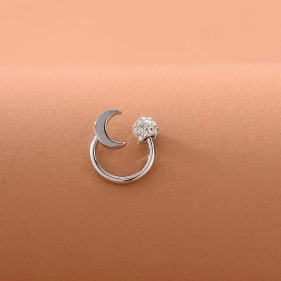 Silver body jewelry with moon detail